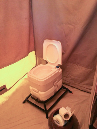 Chemical toilet in tent